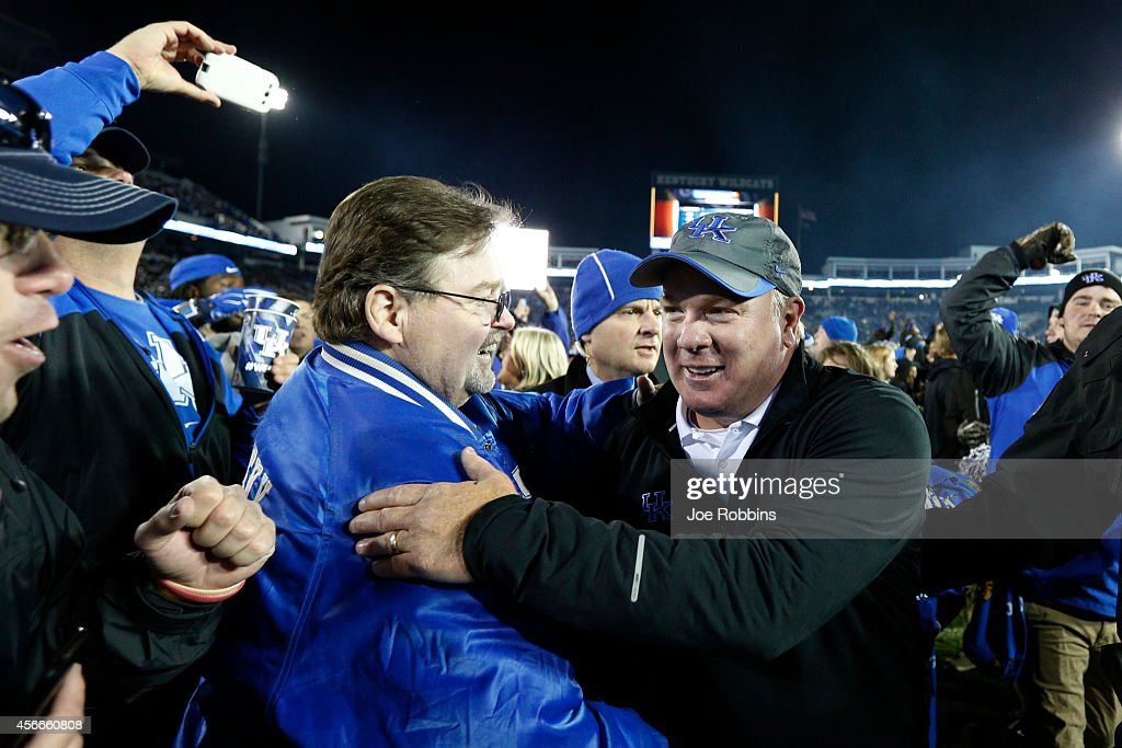 Head coach <a gi-track='captionPersonalityLinkClicked' href=/galleries/search?phrase=Mark+Stoops&family=editorial&specificpeople=4957711 ng-click='$event.stopPropagation()'>Mark Stoops</a> of the Kentucky Wildcats is congratulated by fans after the game against the South Carolina Gamecocks at Commonwealth Stadium on October 4, 2014 in Lexington, Kentucky. Kentucky defeated South Carolina 45-38.