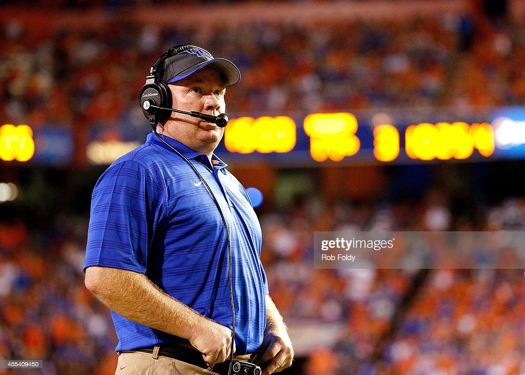 Head coach <a gi-track='captionPersonalityLinkClicked' href=/galleries/search?phrase=Mark+Stoops&family=editorial&specificpeople=4957711 ng-click='$event.stopPropagation()'>Mark Stoops</a> of the Kentucky Wildcats looks on during the second half of the game against the Florida Gators at Ben Hill Griffin Stadium on September 13, 2014 in Gainesville, Florida.