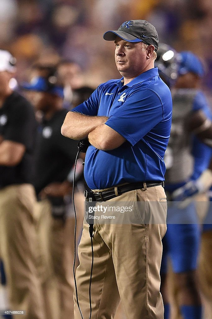 Head coach <a gi-track='captionPersonalityLinkClicked' href=/galleries/search?phrase=Mark+Stoops&family=editorial&specificpeople=4957711 ng-click='$event.stopPropagation()'>Mark Stoops</a> of the Kentucky Wildcats watches action during the third quarter of a game against the LSU Tigers at Tiger Stadium on October 18, 2014 in Baton Rouge, Louisiana. LSU won the game 41-3.
