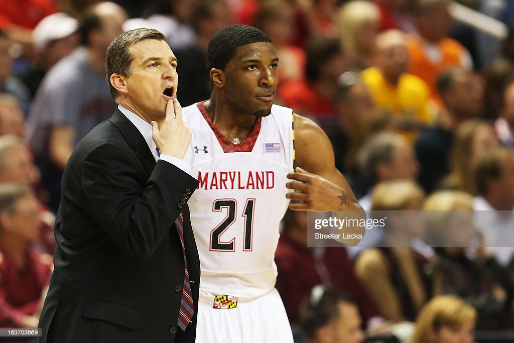 Head coach Mark Turgeon and Pe'Shon Howard #21 of the Maryland Terrapins reacts in the second half against the Wake Forest Demon Deacons during the first round of the Men's ACC Basketball Tournament at Greensboro Coliseum on March 14, 2013 in Greensboro, North Carolina.