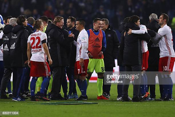 Head coach Markus Gisdol and Bobby Wood of Hamburg celebrate after the Bundesliga match between Hamburger SV and FC Schalke 04 at Volksparkstadion on...