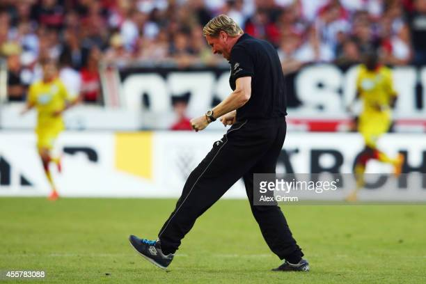 Head coach Markus Gisdol of Hoffenheim celebrates on the pitch after Tarik Elyounoussi scored his team's second goal during the Bundesliga match...
