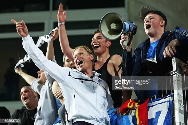 Head coach Markus Gisdol of Hoffenheim celebrates winning with fans after the Bundesliga Playoff Second Leg match between 1 FC Kaiserslautern and...