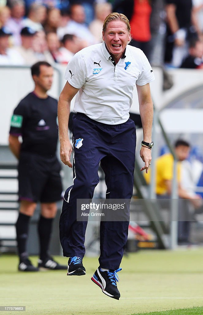Head coach Markus Gisdol of Hoffenheim reacts during the Bundesliga match between 1899 Hoffenheim and SC Freiburg at Wirsol Rhein-Neckar-Arena on August 24, 2013 in Sinsheim, Germany.