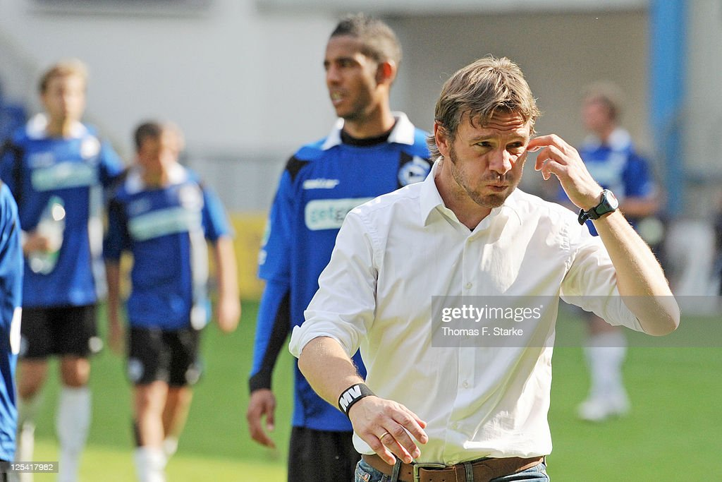 Head coach Markus von Ahlen of Bielefeld leaves the pitch dejected after the Third League match between Arminia Bielefeld and 1. FC Saarbruecken at the Schueco Arena on September 17, 2011 in Bielefeld, Germany.