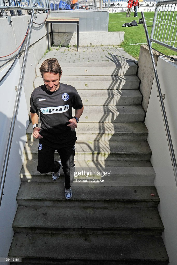 Head coach Markus von Ahlen of Bielefeld leaves the pitch prior to the Third League match between Arminia Bielefeld and 1. FC Saarbruecken at the Schueco Arena on September 17, 2011 in Bielefeld, Germany.