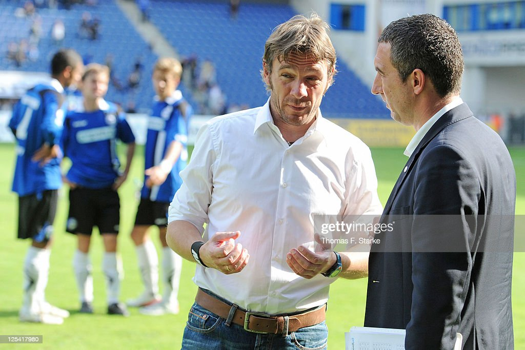 Head coach Markus von Ahlen (2nd R) talks to press spokesman Marcus Uhlig of Bielefeld during the Third League match between Arminia Bielefeld and 1. FC Saarbruecken at the Schueco Arena on September 17, 2011 in Bielefeld, Germany.