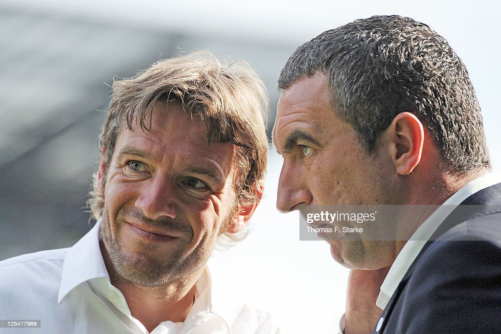 Head coach Markus von Ahlen (L) talks to press spokesman Marcus Uhlig of Bielefeld during the Third League match between Arminia Bielefeld and 1. FC Saarbruecken at the Schueco Arena on September 17, 2011 in Bielefeld, Germany.