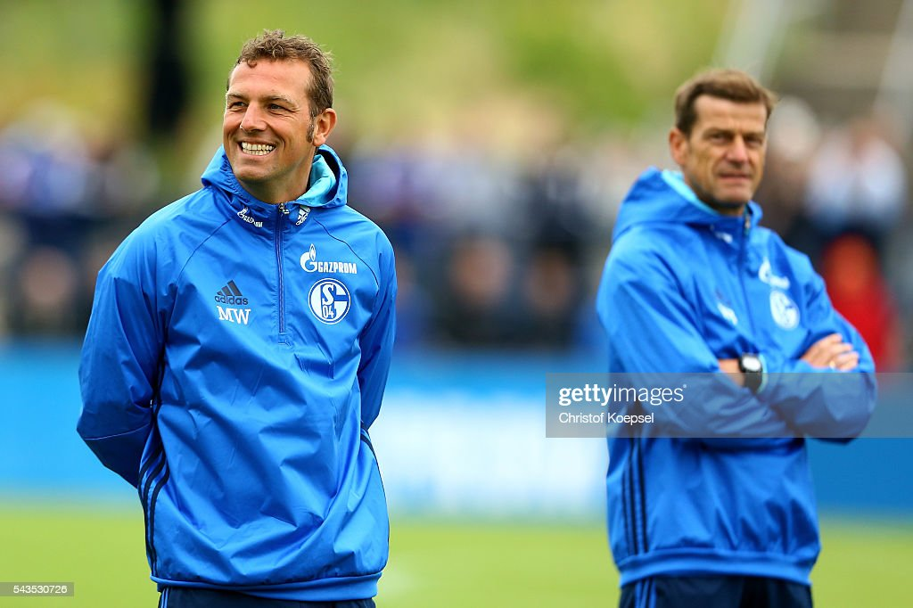 Head coach <a gi-track='captionPersonalityLinkClicked' href=/galleries/search?phrase=Markus+Weinzierl&family=editorial&specificpeople=5848121 ng-click='$event.stopPropagation()'>Markus Weinzierl</a> and assistant coach assistant coach Wolfgang Beller attend the training session of Schalke 04 at training ground on June 29, 2016 in Gelsenkirchen, Germany.