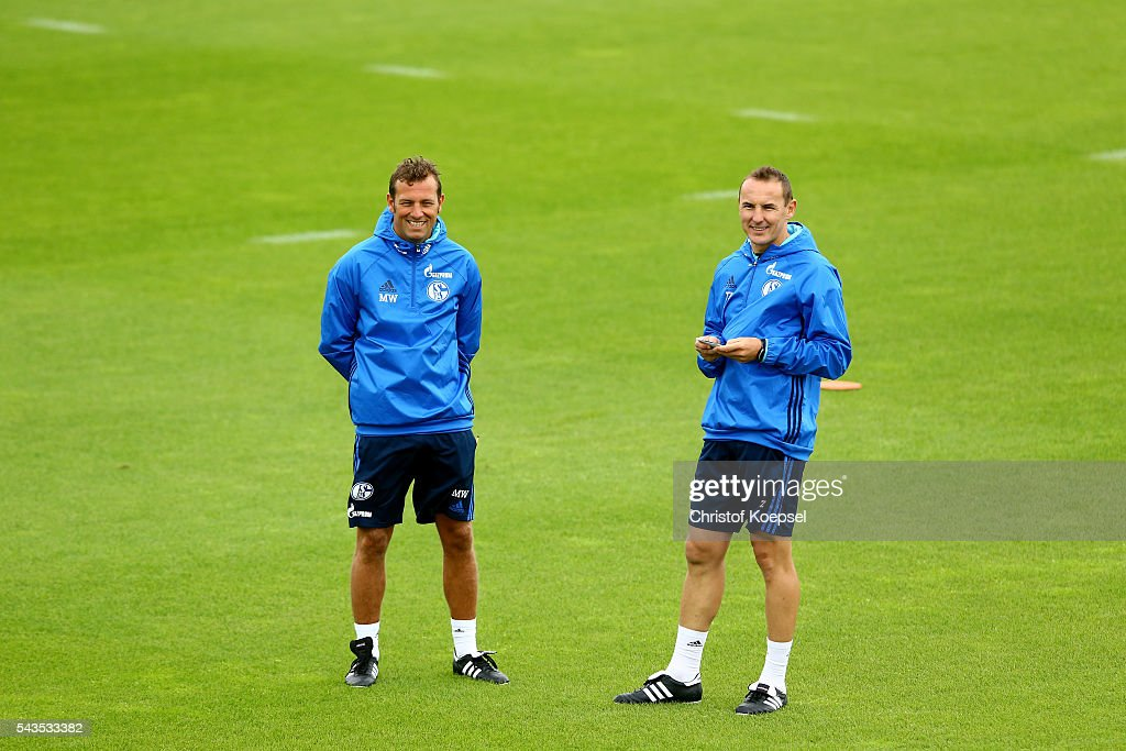 Head coach <a gi-track='captionPersonalityLinkClicked' href=/galleries/search?phrase=Markus+Weinzierl&family=editorial&specificpeople=5848121 ng-click='$event.stopPropagation()'>Markus Weinzierl</a> and assistant coach Tobias Zellner attend during the training session of Schalke 04 at training ground on June 29, 2016 in Gelsenkirchen, Germany.