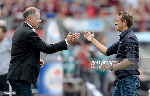 Head coach Markus Weinzierl and CEO Stefan Reuter of Augsburg celebrate after winning the Bundesliga match between 1 FC Nuernberg and FC Augsburg at...