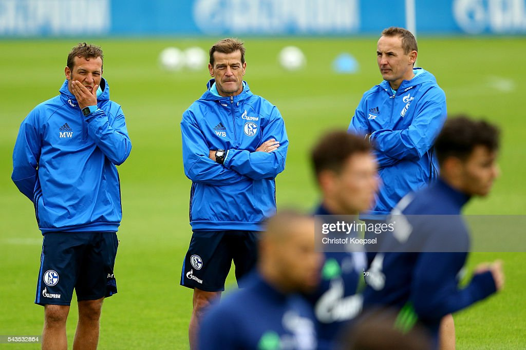 Head coach <a gi-track='captionPersonalityLinkClicked' href=/galleries/search?phrase=Markus+Weinzierl&family=editorial&specificpeople=5848121 ng-click='$event.stopPropagation()'>Markus Weinzierl</a>, assistant coach coach Wolfgang Beller and assistant coach Tobias Zellner attend the training session of Schalke 04 at training ground on June 29, 2016 in Gelsenkirchen, Germany.