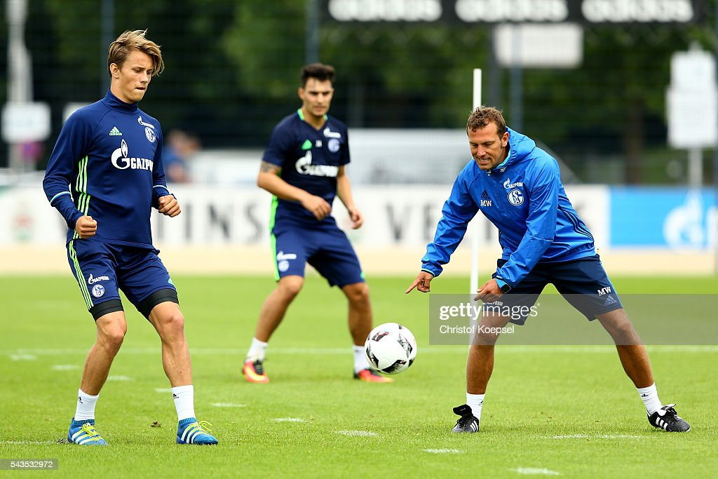 Head coach <a gi-track='captionPersonalityLinkClicked' href=/galleries/search?phrase=Markus+Weinzierl&family=editorial&specificpeople=5848121 ng-click='$event.stopPropagation()'>Markus Weinzierl</a> (R) attends the training session of Schalke 04 at training ground on June 29, 2016 in Gelsenkirchen, Germany.