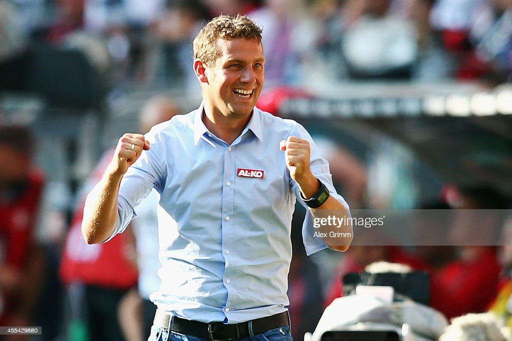 Head coach <a gi-track='captionPersonalityLinkClicked' href=/galleries/search?phrase=Markus+Weinzierl&family=editorial&specificpeople=5848121 ng-click='$event.stopPropagation()'>Markus Weinzierl</a> of Augsburg celebrates after the Bundesliga match between Eintracht Frankfurt and FC Augsburg at Commerzbank-Arena on September 14, 2014 in Frankfurt am Main, Germany.