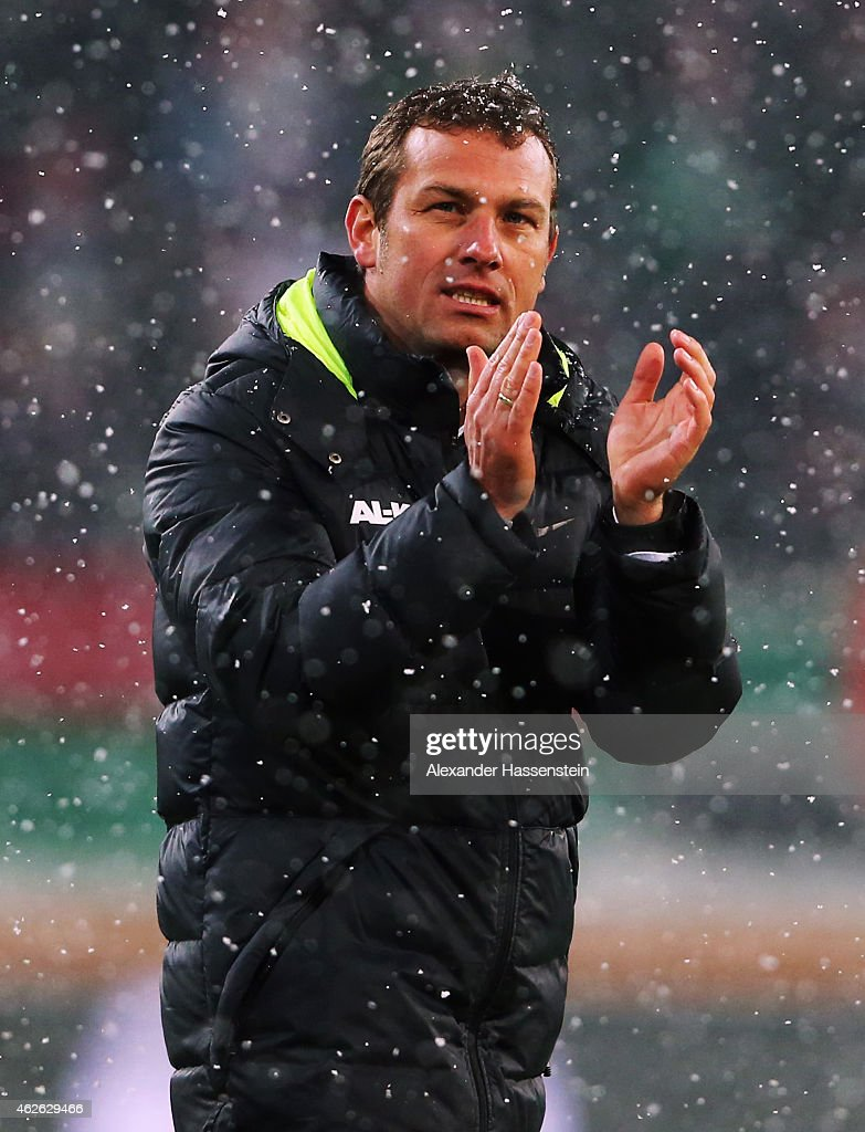 Head coach <a gi-track='captionPersonalityLinkClicked' href=/galleries/search?phrase=Markus+Weinzierl&family=editorial&specificpeople=5848121 ng-click='$event.stopPropagation()'>Markus Weinzierl</a> of Augsburg celebrates after the Bundesliga match between FC Augsburg and 1899 Hoffenheim at SGL Arena on February 1, 2015 in Augsburg, Germany.