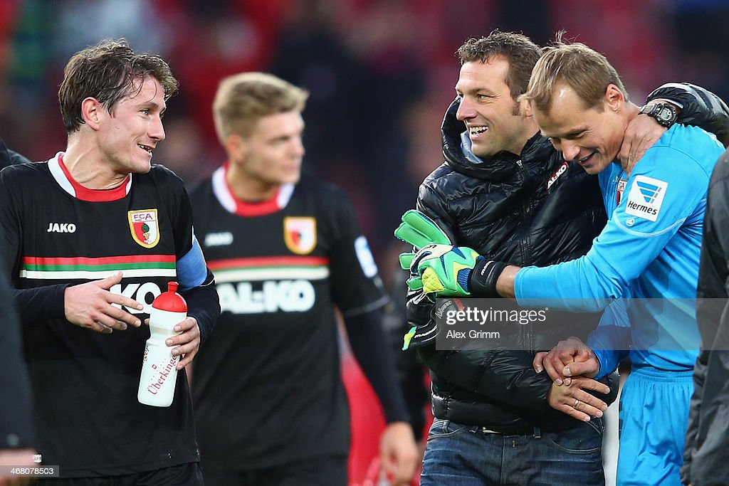 Head coach <a gi-track='captionPersonalityLinkClicked' href=/galleries/search?phrase=Markus+Weinzierl&family=editorial&specificpeople=5848121 ng-click='$event.stopPropagation()'>Markus Weinzierl</a> of Augsburg celebrates with goalkeeper <a gi-track='captionPersonalityLinkClicked' href=/galleries/search?phrase=Alexander+Manninger&family=editorial&specificpeople=167082 ng-click='$event.stopPropagation()'>Alexander Manninger</a> and Paul Verhaegh after the Bundesliga match between VfB Stuttgart and FC Augsburg at Mercedes-Benz Arena on February 9, 2014 in Stuttgart, Germany.