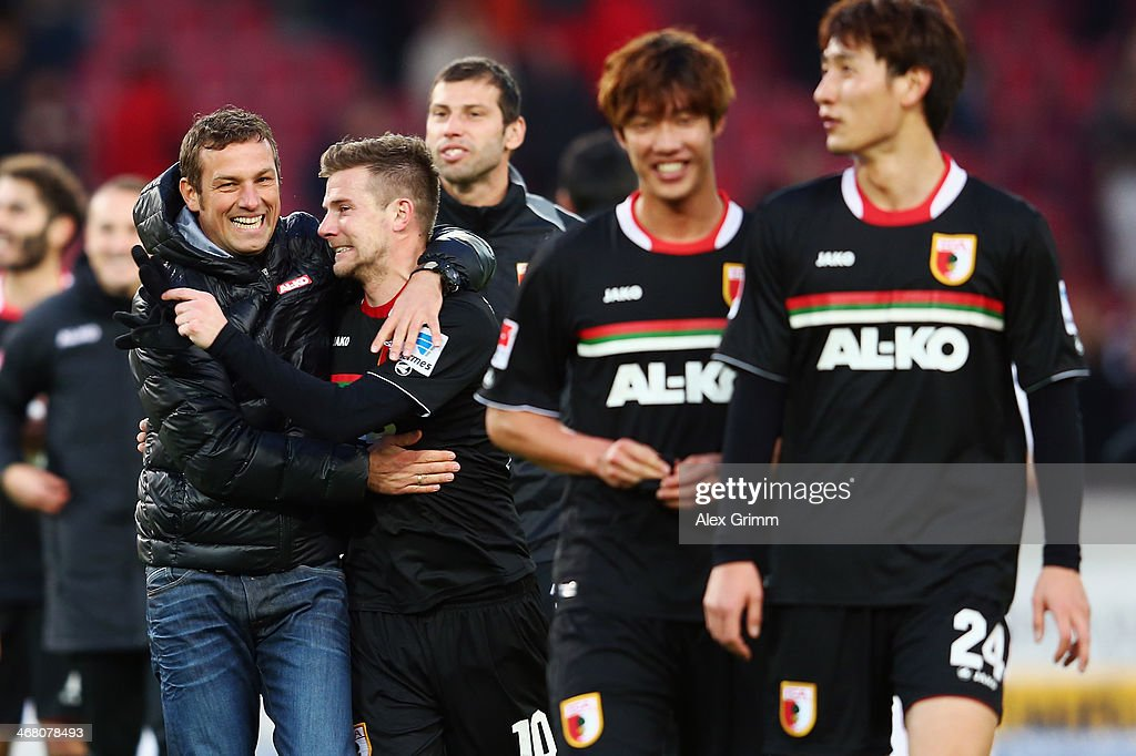 Head coach <a gi-track='captionPersonalityLinkClicked' href=/galleries/search?phrase=Markus+Weinzierl&family=editorial&specificpeople=5848121 ng-click='$event.stopPropagation()'>Markus Weinzierl</a> of Augsburg hugs <a gi-track='captionPersonalityLinkClicked' href=/galleries/search?phrase=Daniel+Baier&family=editorial&specificpeople=706624 ng-click='$event.stopPropagation()'>Daniel Baier</a> after the Bundesliga match between VfB Stuttgart and FC Augsburg at Mercedes-Benz Arena on February 9, 2014 in Stuttgart, Germany.