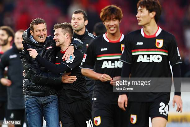 Head coach Markus Weinzierl of Augsburg hugs Daniel Baier after the Bundesliga match between VfB Stuttgart and FC Augsburg at MercedesBenz Arena on...
