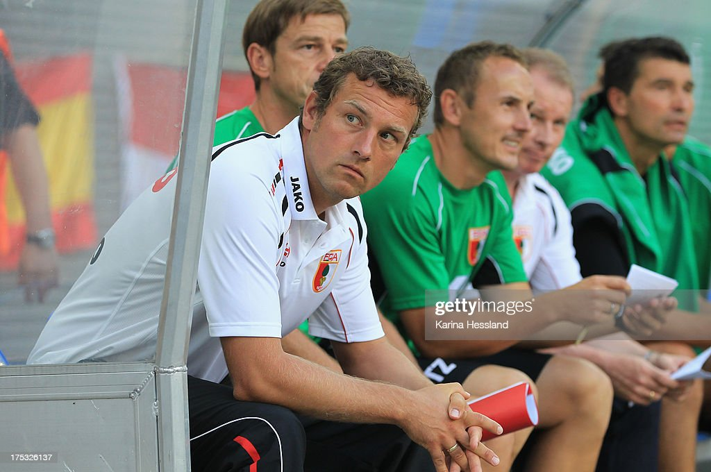 Head coach <a gi-track='captionPersonalityLinkClicked' href=/galleries/search?phrase=Markus+Weinzierl&family=editorial&specificpeople=5848121 ng-click='$event.stopPropagation()'>Markus Weinzierl</a> of Augsburg looks on during the DFB Cup between RB Leipzig and FC Augsburg at Zentralstadion on August 02, 2013 in Leipzig, Germany.