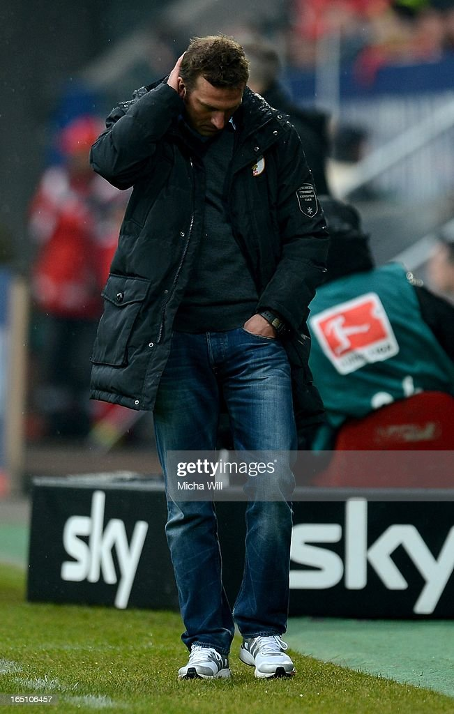 Head coach <a gi-track='captionPersonalityLinkClicked' href=/galleries/search?phrase=Markus+Weinzierl&family=editorial&specificpeople=5848121 ng-click='$event.stopPropagation()'>Markus Weinzierl</a> of Augsburg reacts during the Bundesliga match between FC Augsburg and Hannover 96 at SGL Arena on March 30, 2013 in Augsburg, Germany.