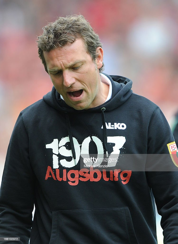 Head coach <a gi-track='captionPersonalityLinkClicked' href=/galleries/search?phrase=Markus+Weinzierl&family=editorial&specificpeople=5848121 ng-click='$event.stopPropagation()'>Markus Weinzierl</a> of Augsburg reacts during the Bundesliga match between SC Freiburg and FC Augsburg at MAGE SOLAR Stadium on May 5, 2013 in Freiburg, Germany.