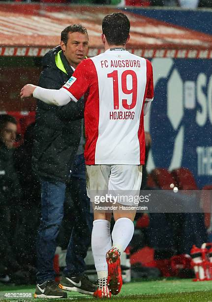 Head coach Markus Weinzierl of Augsburg shakes hands with PierreEmile Hojbjerg during the Bundesliga match between FC Augsburg and 1899 Hoffenheim at...
