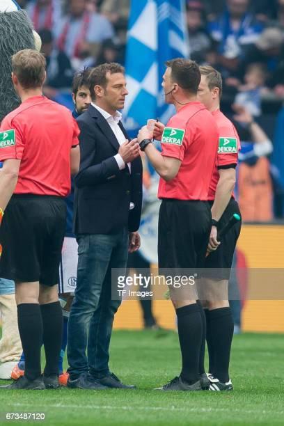 Head coach Markus Weinzierl of Schalke speak with Referee Felix Zwayer during the Bundesliga match between FC Schalke 04 and Borussia Dortmund at...