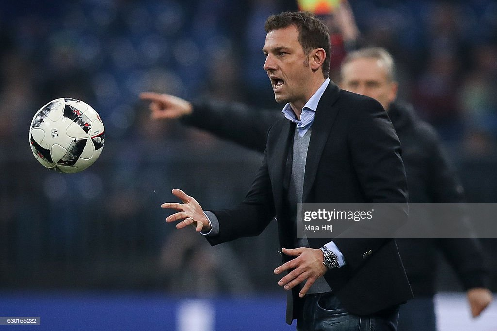 Head coach Markus Weinzierl of Schalke throws the ball during the Bundesliga match between FC Schalke 04 and SC Freiburg at Veltins-Arena on December 17, 2016 in Gelsenkirchen, Germany.