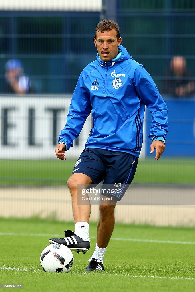 Head coach <a gi-track='captionPersonalityLinkClicked' href=/galleries/search?phrase=Markus+Weinzierl&family=editorial&specificpeople=5848121 ng-click='$event.stopPropagation()'>Markus Weinzierl</a> runs with the ball during the training session of Schalke 04 at training ground on June 29, 2016 in Gelsenkirchen, Germany.