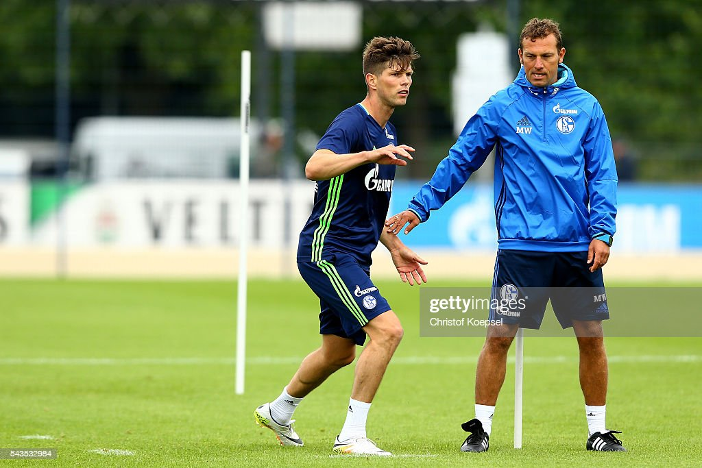 Head coach <a gi-track='captionPersonalityLinkClicked' href=/galleries/search?phrase=Markus+Weinzierl&family=editorial&specificpeople=5848121 ng-click='$event.stopPropagation()'>Markus Weinzierl</a> (R) watches Klaas-Jan Huntelaar (L) during the training session of Schalke 04 at training ground on June 29, 2016 in Gelsenkirchen, Germany.