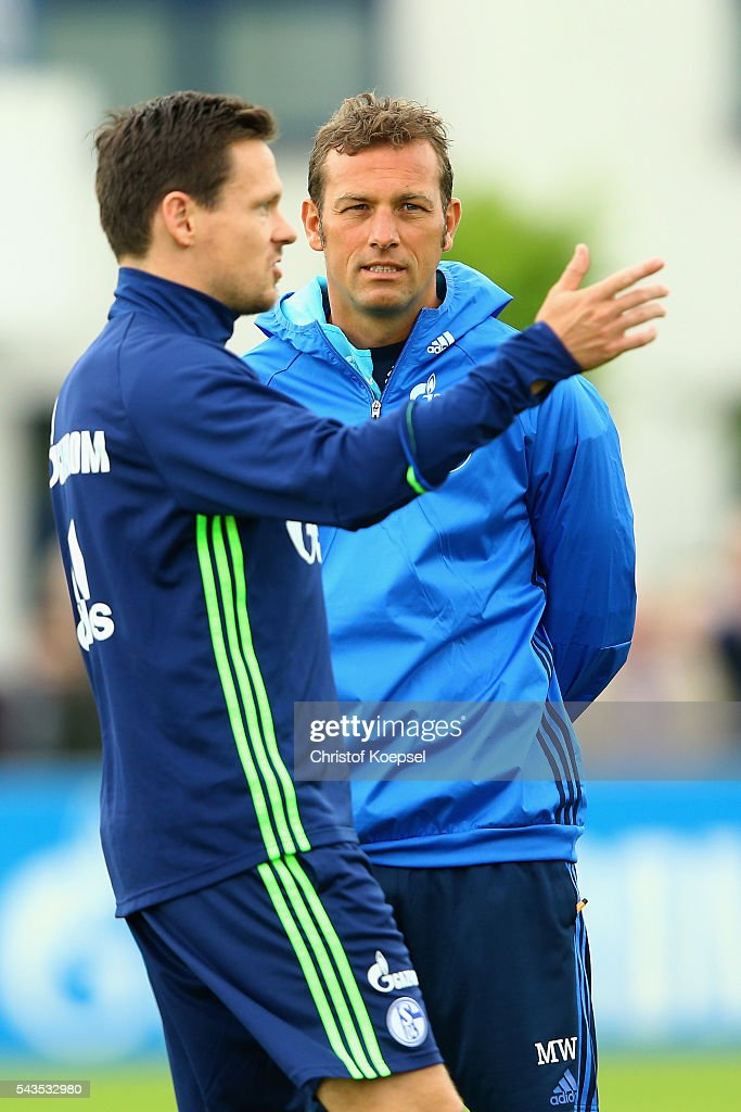 Head coach <a gi-track='captionPersonalityLinkClicked' href=/galleries/search?phrase=Markus+Weinzierl&family=editorial&specificpeople=5848121 ng-click='$event.stopPropagation()'>Markus Weinzierl</a> (R) watches <a gi-track='captionPersonalityLinkClicked' href=/galleries/search?phrase=Sascha+Riether&family=editorial&specificpeople=614139 ng-click='$event.stopPropagation()'>Sascha Riether</a> (L) during the training session of Schalke 04 at training ground on June 29, 2016 in Gelsenkirchen, Germany.