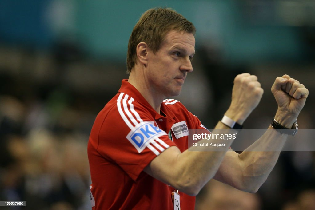 Head coach <a gi-track='captionPersonalityLinkClicked' href=/galleries/search?phrase=Martin+Heuberger&family=editorial&specificpeople=2084797 ng-click='$event.stopPropagation()'>Martin Heuberger</a> of Germany celebrates during the premilary group A match between Germany and Argentina at Palacio de Deportes de Granollers on January 15, 2013 in Granollers, Spain.