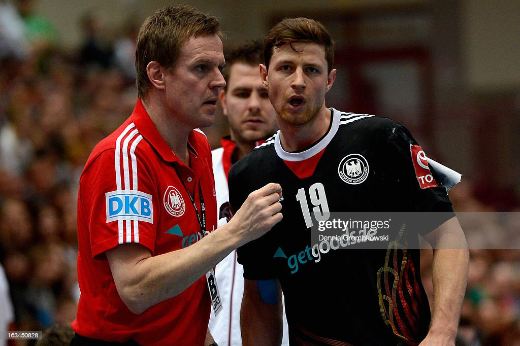 Head coach <a gi-track='captionPersonalityLinkClicked' href=/galleries/search?phrase=Martin+Heuberger&family=editorial&specificpeople=2084797 ng-click='$event.stopPropagation()'>Martin Heuberger</a> of Germany gives instructions to <a gi-track='captionPersonalityLinkClicked' href=/galleries/search?phrase=Martin+Strobel&family=editorial&specificpeople=4479733 ng-click='$event.stopPropagation()'>Martin Strobel</a> during the DHB International Friendly match between Germany and Switzerland at Conlog-Arena on March 10, 2013 in Koblenz am Rhein, Germany.