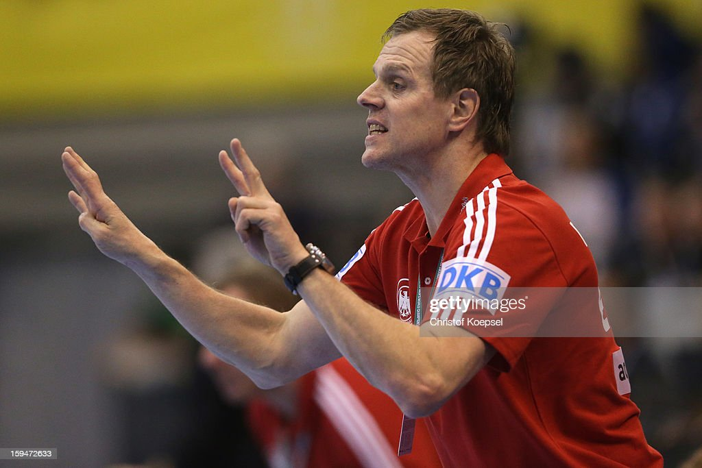 Head coach <a gi-track='captionPersonalityLinkClicked' href=/galleries/search?phrase=Martin+Heuberger&family=editorial&specificpeople=2084797 ng-click='$event.stopPropagation()'>Martin Heuberger</a> of Germany issues instructions during the premilary group A match between Tunisia and Germany at Palacio de Deportes de Granollers on January 13, 2013 in Granollers, Spain.