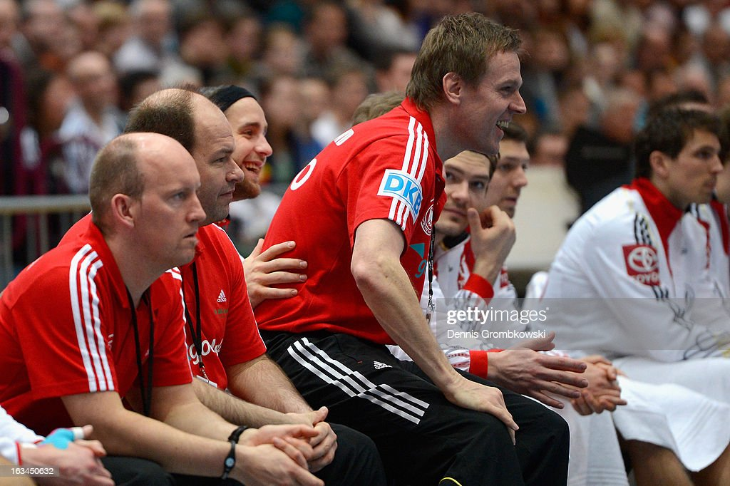 Head coach Martin Heuberger of Germany jokes with goalkeeper Silvio Heinevetter during the DHB International Friendly match between Germany and Switzerland at Conlog-Arena on March 10, 2013 in Koblenz am Rhein, Germany.