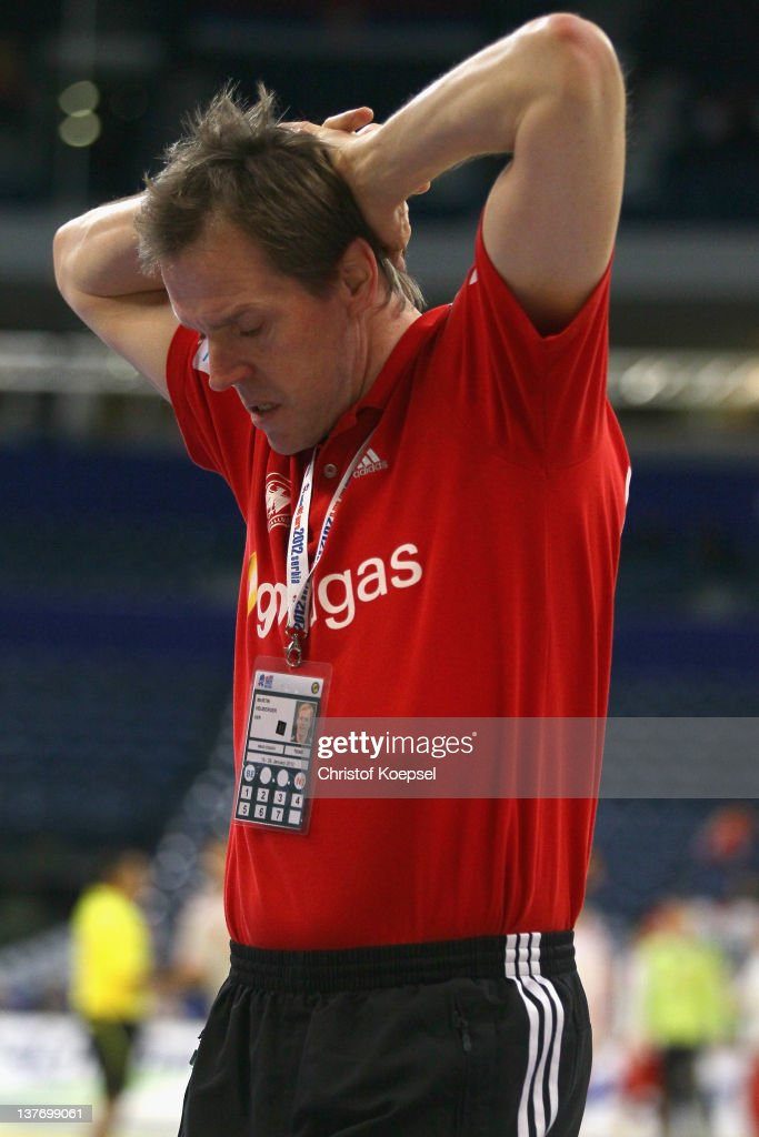 Head coach <a gi-track='captionPersonalityLinkClicked' href=/galleries/search?phrase=Martin+Heuberger&family=editorial&specificpeople=2084797 ng-click='$event.stopPropagation()'>Martin Heuberger</a> of Germany looks dejected after losing 32-33 the the Men's European Handball Championship second round group one match between Poland and Germany at Beogradska Arena on January 25, 2012 in Belgrade, Serbia.