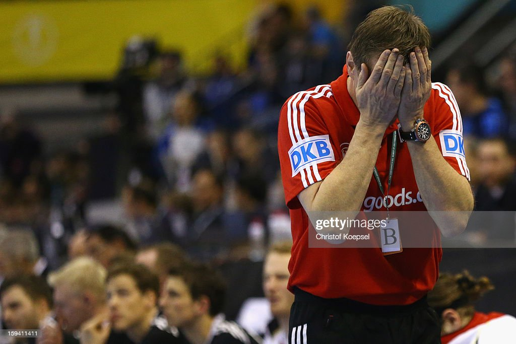 Head coach <a gi-track='captionPersonalityLinkClicked' href=/galleries/search?phrase=Martin+Heuberger&family=editorial&specificpeople=2084797 ng-click='$event.stopPropagation()'>Martin Heuberger</a> of Germany looks dejected after the premilary group A match between Tunisia and Germany at Palacio de Deportes de Granollers on January 13, 2013 in Granollers, Spain. The match between Tunisia and Germany ended 25-23.