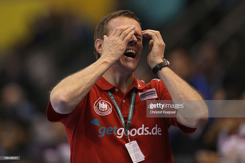 Head coach <a gi-track='captionPersonalityLinkClicked' href=/galleries/search?phrase=Martin+Heuberger&family=editorial&specificpeople=2084797 ng-click='$event.stopPropagation()'>Martin Heuberger</a> of Germany looks dejected during the premilary group A match between Tunisia and Germany at Palacio de Deportes de Granollers on January 13, 2013 in Granollers, Spain.