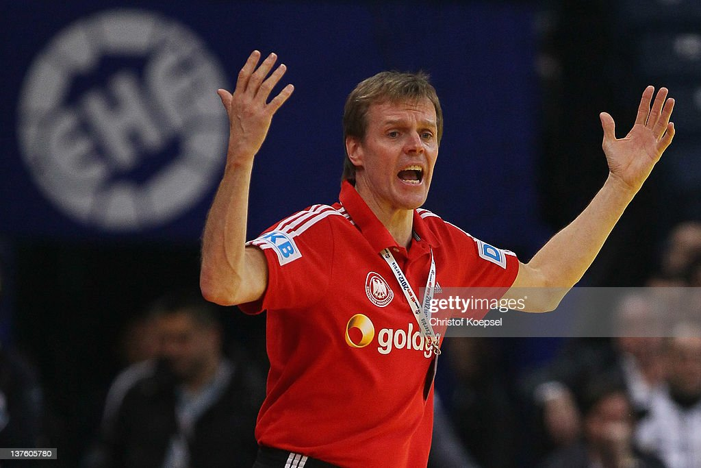 Head coach <a gi-track='captionPersonalityLinkClicked' href=/galleries/search?phrase=Martin+Heuberger&family=editorial&specificpeople=2084797 ng-click='$event.stopPropagation()'>Martin Heuberger</a> of Germany looks dejected during the Men's European Handball Championship second round group one match between Denmark and Germany at Beogradska Arena on January 23, 2012 in Belgrade, Serbia.