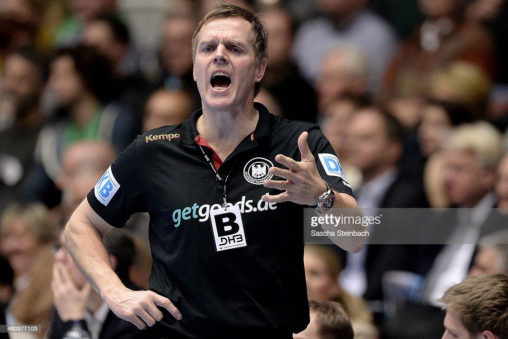 Head coach <a gi-track='captionPersonalityLinkClicked' href=/galleries/search?phrase=Martin+Heuberger&family=editorial&specificpeople=2084797 ng-click='$event.stopPropagation()'>Martin Heuberger</a> of Germany reacts during the DHB Four Nations Tournament match between Germany and Austria at Westfalenhalle on January 3, 2014 in Dortmund, Germany.
