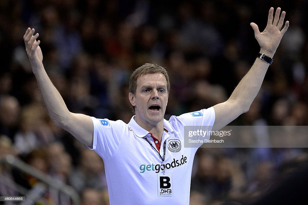 Head coach <a gi-track='captionPersonalityLinkClicked' href=/galleries/search?phrase=Martin+Heuberger&family=editorial&specificpeople=2084797 ng-click='$event.stopPropagation()'>Martin Heuberger</a> of Germany reacts during the DHB Four Nations Tournament match between Germany and Russia at KoenigPALAST on January 4, 2014 in Krefeld, Germany.