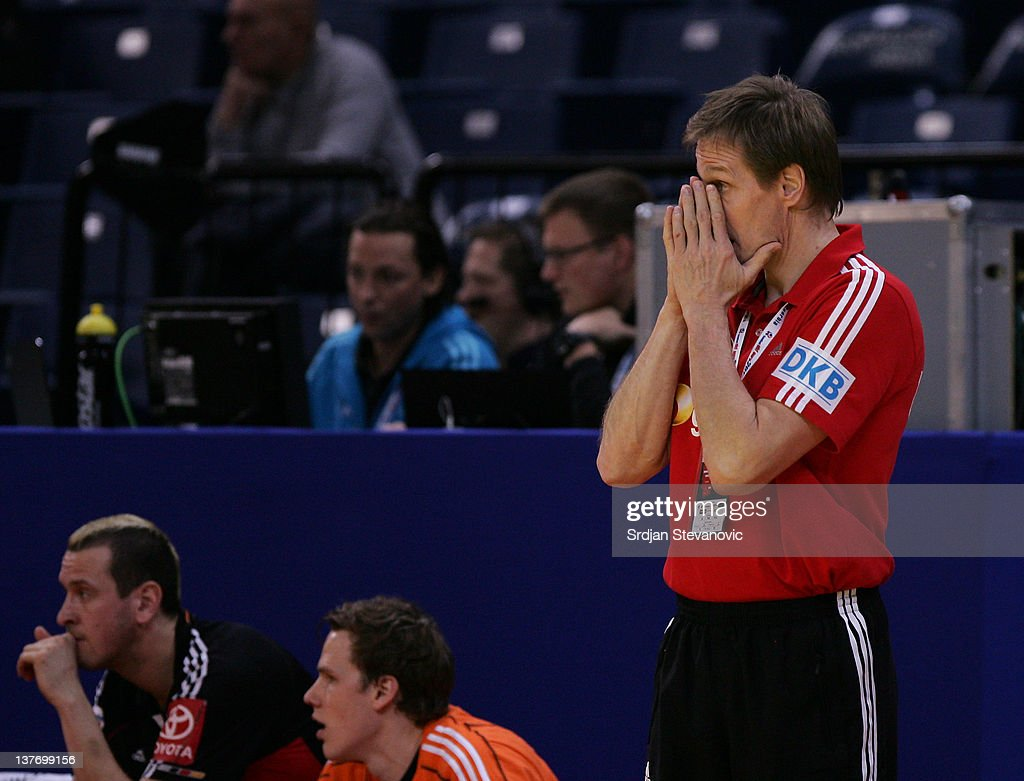 Head coach Martin Heuberger (R) reacts during the Men's European Handball Championship 2012 second round group one match between Poland and Germany at Arena Hall on January 25, 2012 in Belgrade, Serbia.