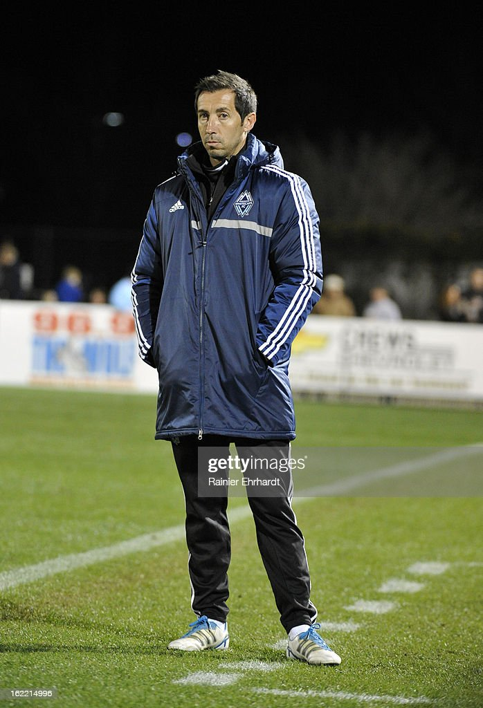 Head coach Martin Rennie of the Vancouver Whitecaps FC looks on during the second half of a game against the Houston Dyamo on February 20, 2013 in Charleston, North Carolina.
