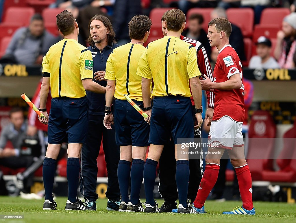 Head coach Martin Schmidt of 1. FSV Mainz 05 talks to referees after the Bundesliga match between 1. FSV Mainz 05 and Hamburger SV at Coface Arena on April 30, 2016 in Mainz, Germany.