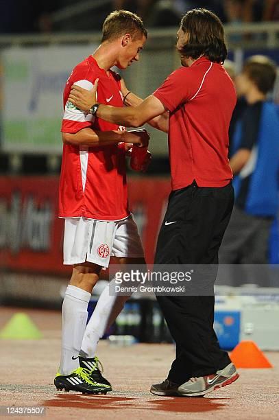 Head Coach Martin Schmidt of Mainz hugs Erik Durm during the Regionalliga West match between SV Eintracht Trier 05 and FSV Mainz 05 II at...