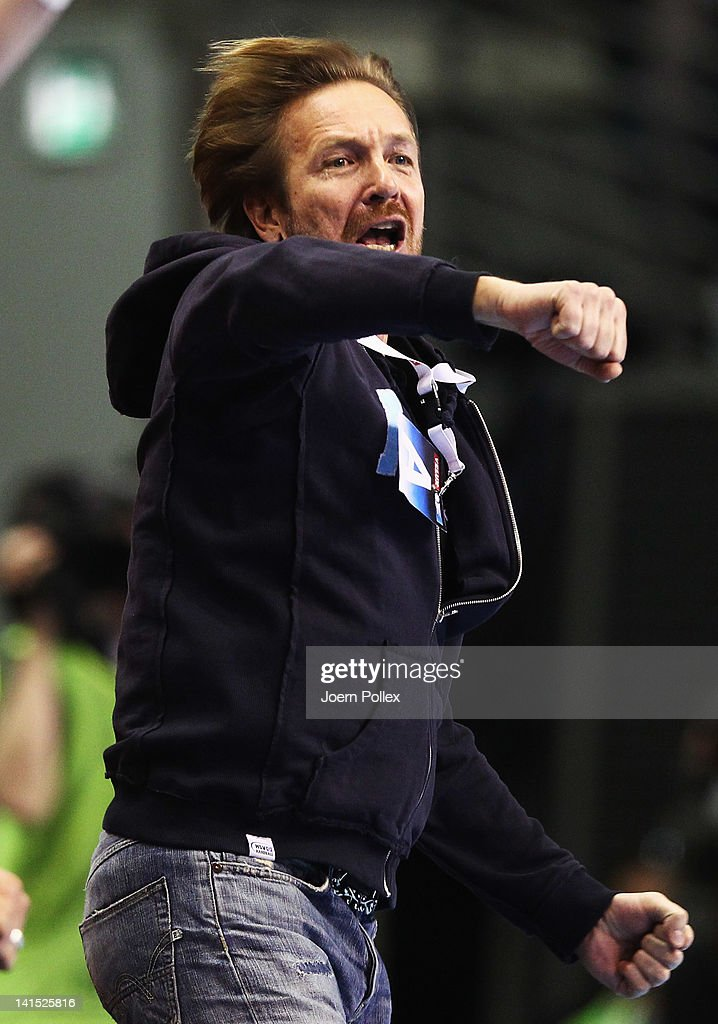 Head coach Martin Schwalb of Hamburg celebrates during the EHF Champions League round of sixteen match between Fuechse Berlin and HSV Hamburg at Max...