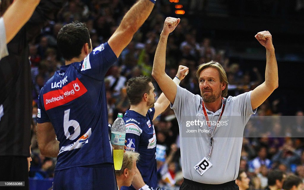 Head coach Martin Schwalb of Hamburg celebrates during the Toyota Handball Bundesliga match between HSV Hamburg and Fuechse Berlin at the o2 World...
