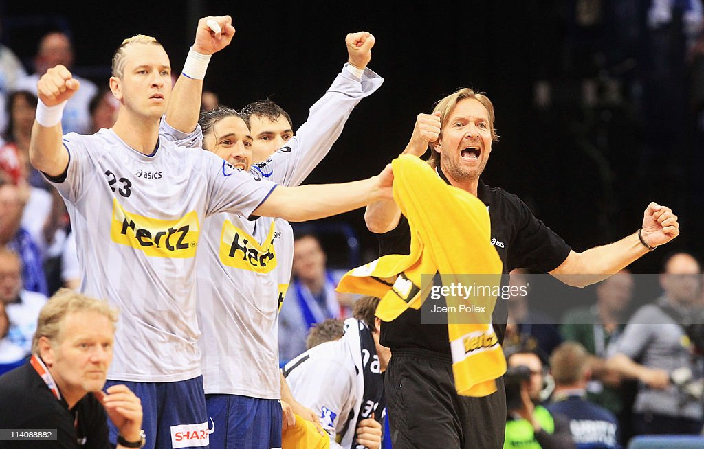 Head coach Martin Schwalb of Hamburg celebrates during the Toyota Handball Bundesliga match between HSV Hamburg and VfL Gummersbach at the o2 World...