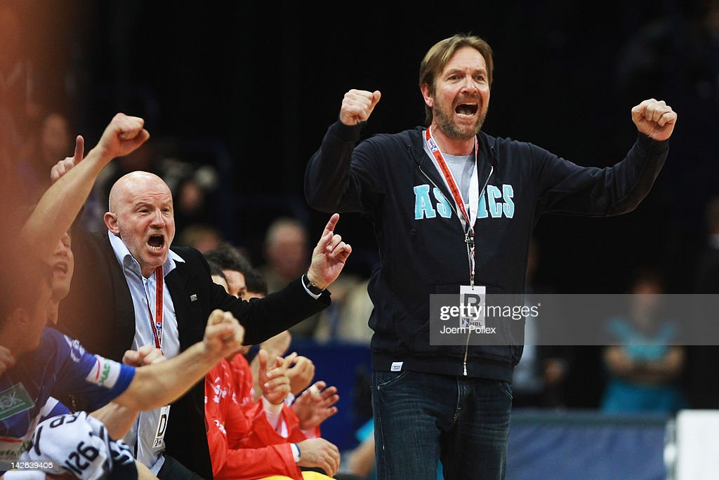 Head coach Martin Schwalb of Hamburg celebrates during the Toyota Bundesliga handball game between HSV Hamburg and RheinNeckar Loewen at the O2 World...