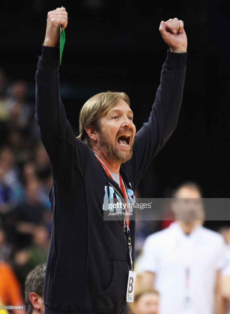 Head coach <a gi-track='captionPersonalityLinkClicked' href=/galleries/search?phrase=Martin+Schwalb&family=editorial&specificpeople=607901 ng-click='$event.stopPropagation()'>Martin Schwalb</a> (R) of Hamburg celebrates during the Toyota Bundesliga handball game between HSV Hamburg and Rhein-Neckar Loewen at the O2 World on April 10, 2012 in Hamburg, Germany.